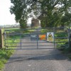 Gated road near Moor Farm