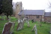 Wolvesnewton parish church with cross in the churchyard