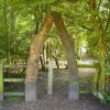 Archway into woodland below the visitors centre, Sale Water Park