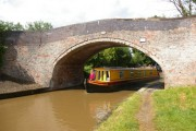 Narrowboat emerging under Bremilow's bridge