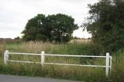 Bridge at field corner in Cranley Green