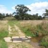 Little stream crossing footpath