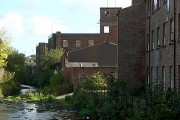 Factory backs along the Bollin