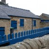 Outbuildings painted Chatsworth blue.
