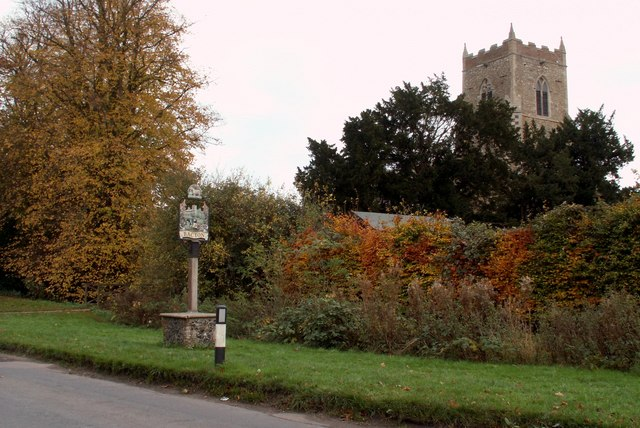 The village sign and St. Mary's church at Bacton