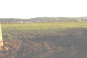 An easterly view across farmland at Rhydolion Farm towards Llanengan village