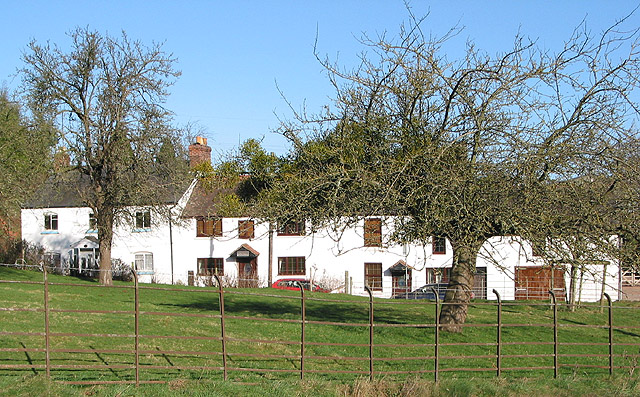 Row of cottages behind a small orchard, Lea