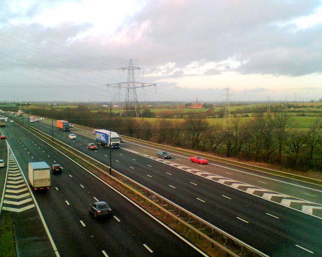 Crossing the M4 motorway by train