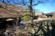 Concrete tramway bridge below reservoir dam