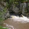 Waterfall stirring up mud