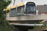 Tram crossing the River Leen