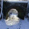 Footpath under a bridge of the Alban Way in winter