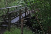 Footbridge using remains of old narrow-gauge railway bridge over Allt a'Mhuilinn