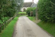 Cruxton: road and cottage