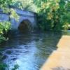 A Swollen Derwent Passes Under The Bridge