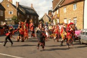 Adderbury High Street with Morris Dancers