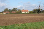 Field with Mere Close Farm beyond