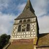 Shingled spire on a timber-framed belfry