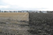Partly ploughed farmland on the North bank of the Tay