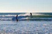 Surfers at Porth Neigwl (Hell's Mouth)