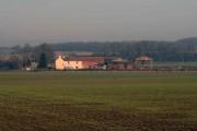 Low farm across the field