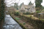 Alport cottage  with river and snowdrops