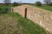 Brick parapet of the old stone bridge