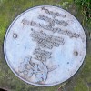 Plaque by tree in Birchwood Forest Park