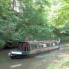 "A passing narrowboat is ""going home"" on the Grand Union Canal"