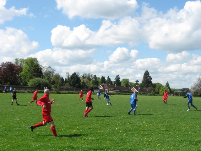 Football on Pound Meadow with London Road, Tring, in the background