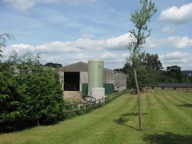 A lawn with trees, beside a 20th century farm barn, near Tring Station