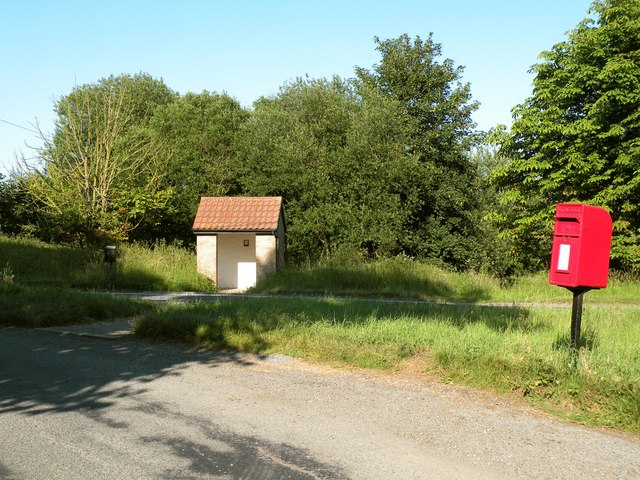 A bus shelter and postbox in Hawstead village