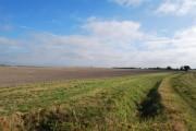 View across field towards main road.