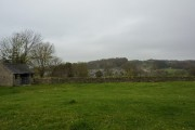 Looking over a paddock to Birchover