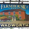 Sign for the Farmhouse Inn
