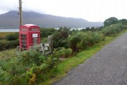 Red phone box on isolated lane.