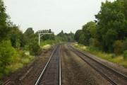 The railway line crosses Grange Road in Tuffley