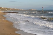 Boscombe: rough seas and view along beach