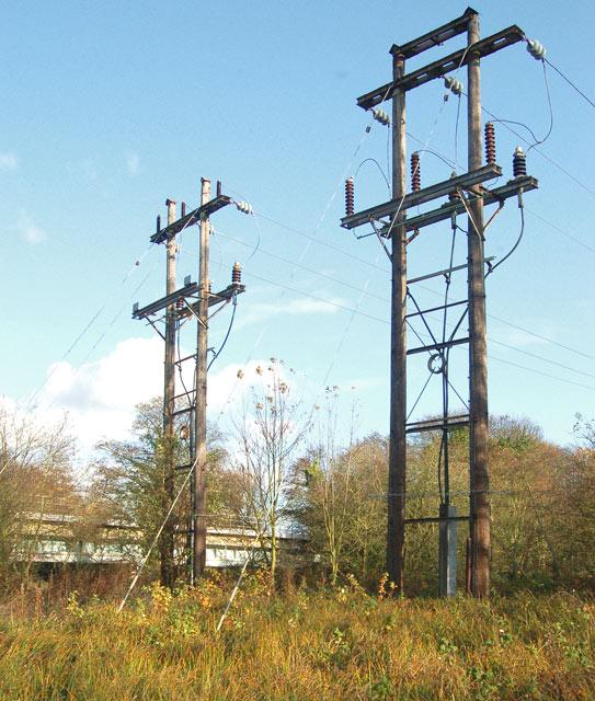 Power poles by the railway bridge over the River Avon, Warwick