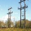 Power poles by the railway bridge over the River Avon, Warwick