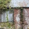Wood, stone and corrugated iron