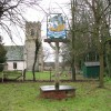 Blo' Norton village sign and St Andrew's church