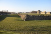 The moat and outer ward of Flint Castle