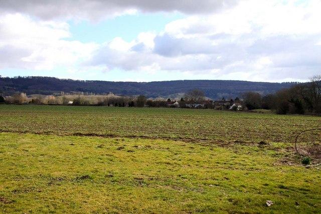 Looking across farmland towards Birdlip