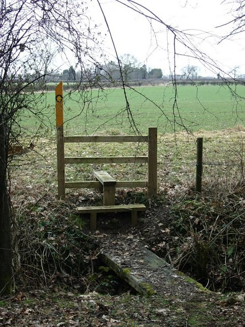 Stile and exit north from Shawell Wood