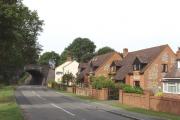 Houses and railway bridge, on B4009 at Longwick